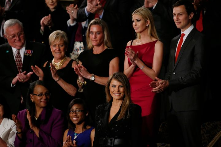 First lady Melania Trump, bottom center, is applauded as her husband begins his speech. Behind her is Trump's daughter Ivanka