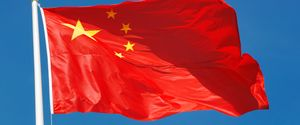 BANNER BLUE BLUE BACKGROUND CHINA CHINESE FLAG CLOSEUP COUNTRY GEOGRAPHIC AREA FLAG FLYING ISOLATED NATIONAL FLAG NO PEOPLE OUTDOORS RED SKY