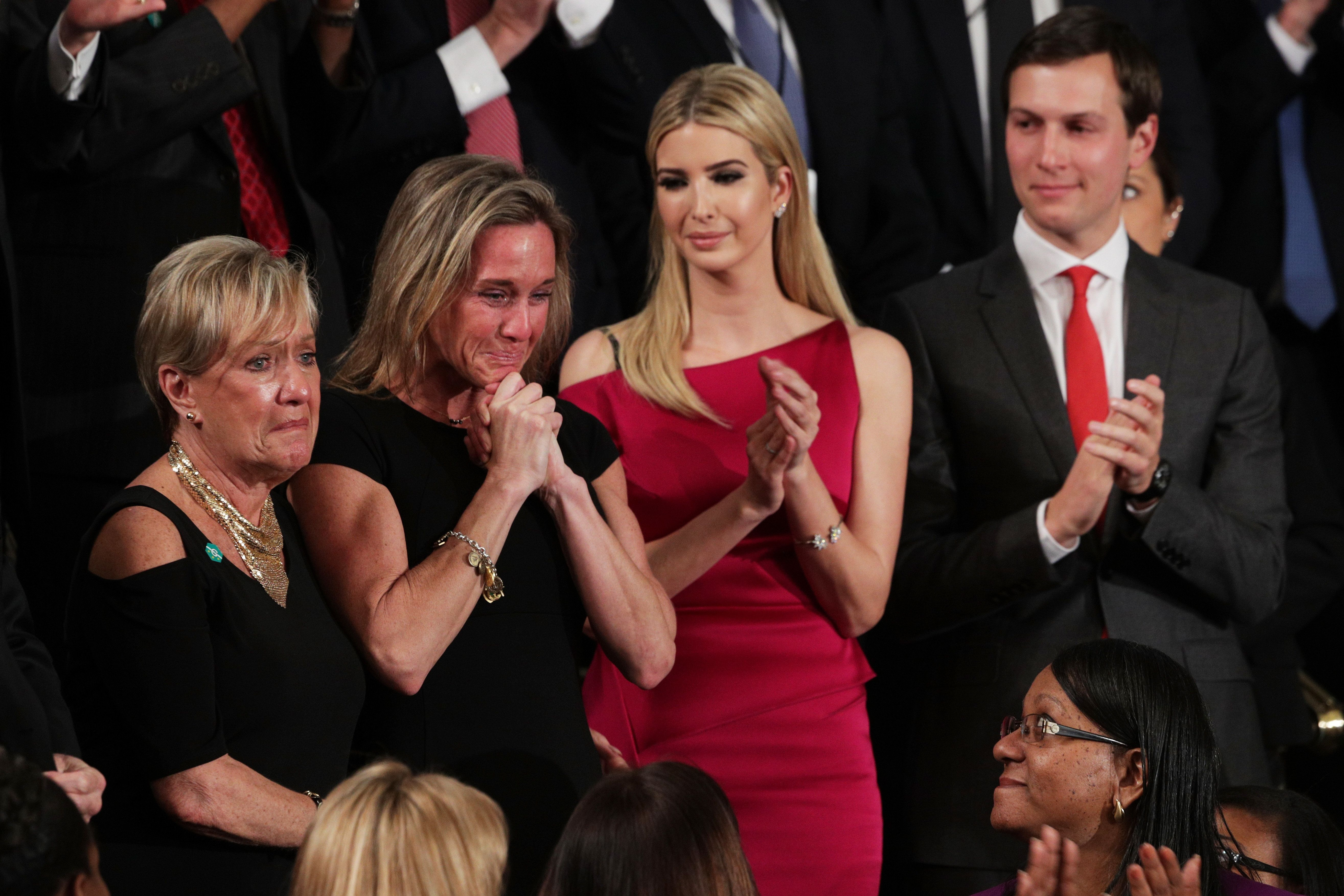 WASHINGTON, DC - FEBRUARY 28:  Widow of Fallen Navy Seal, Senior Chief William Owens, Carryn Owens (2ndL), first lady Melania Trump and White House Senior Advisor to the President for Strategic Planning Jared Kushner attend a joint session of the U.S. Congress with U.S. President Donald Trump on February 28, 2017 in the House chamber of  the U.S. Capitol in Washington, DC. Trump's first address to Congress focused on national security, tax and regulatory reform, the economy, and healthcare.  (Photo by Alex Wong/Getty Images)