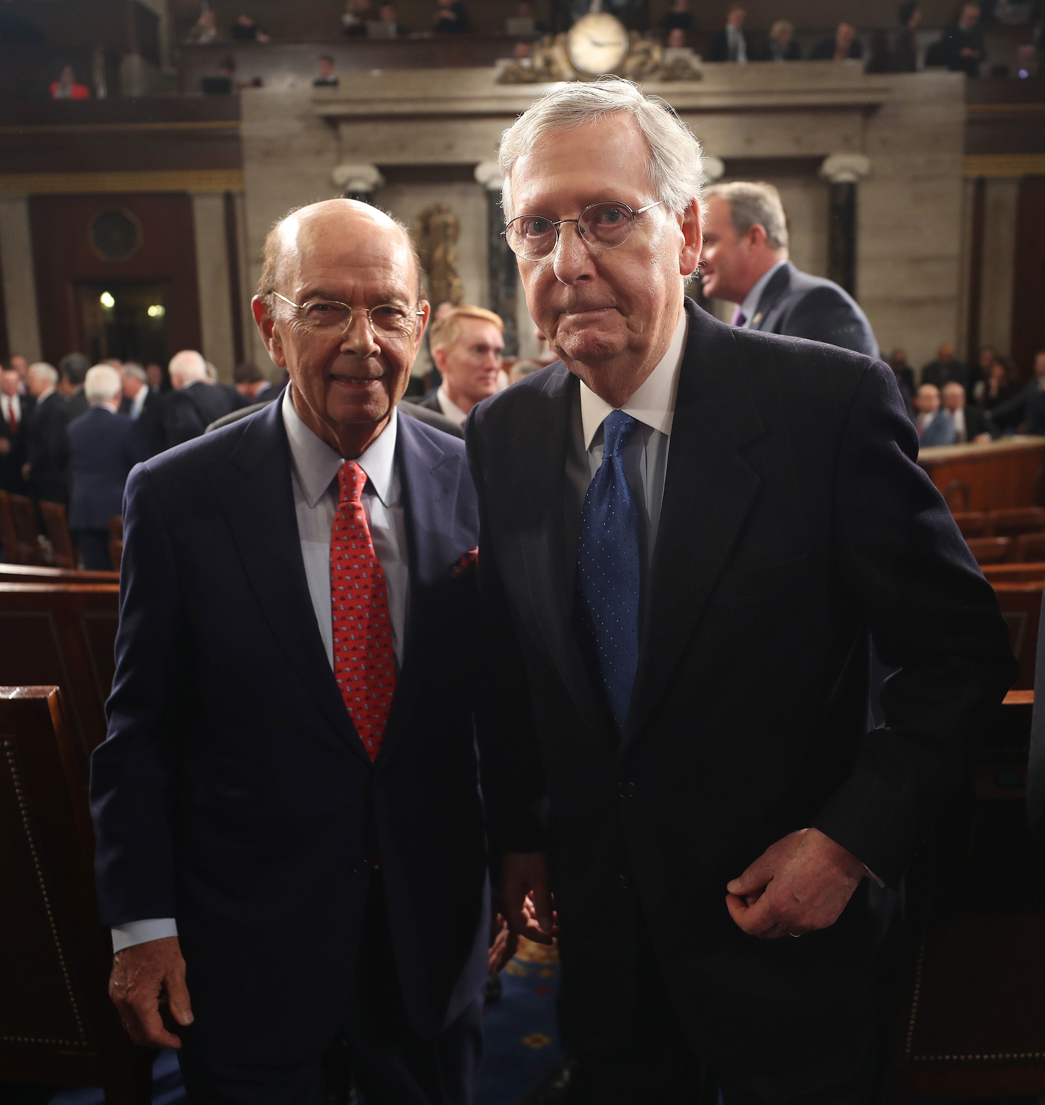 Secretary of Commerce Wilbur Ross (L) and Senate Majority Leader Mitch McConnell of Kentucky (R) depart after US President Donald J. Trump after delivered his first address to a joint session of Congress from the floor of the House of Representatives in Washington, DC, USA, 28 February 2017. / AFP / POOL / JIM LO SCALZO        (Photo credit should read JIM LO SCALZO/AFP/Getty Images)