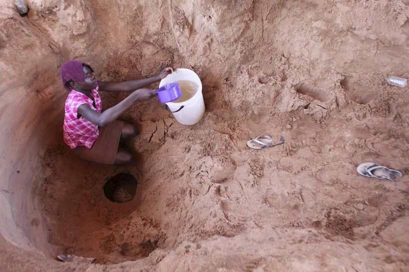 A woman fetching water in Kaaliro, Uganda from a dried up well. The community is threatened by the strong drought that has dr