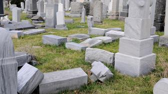 Headstones are seen laying flat at Han Nebo Jewish Cemetery in Northwest Philadelphia, PA, on Feb. 27, 2017. Over the weekend hundreds of headstones were vandalized at the nearby Jewish Mt. Carmel Cemetery. Both sites are under the same management. (Photo by Bastiaan Slabbers/NurPhoto via Getty Images)