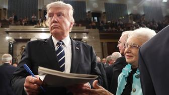 U.S. President Donald Trump signs an autograph after delivering  his first address to a joint session of Congress from the floor of the House of Representatives iin Washington, U.S., February 28, 2017.  REUTERS/Jim Lo Scalzo/Pool