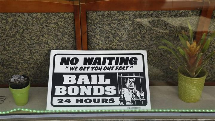A sign in the window of a bail bonds office across from the Hall of Justice in San Francisco. Increasingly, states are reeval