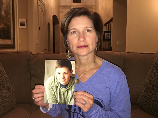 Mindy Corporon holds a photo of her son, Reat Griffin Underwood, who, along with her father, was killed...
