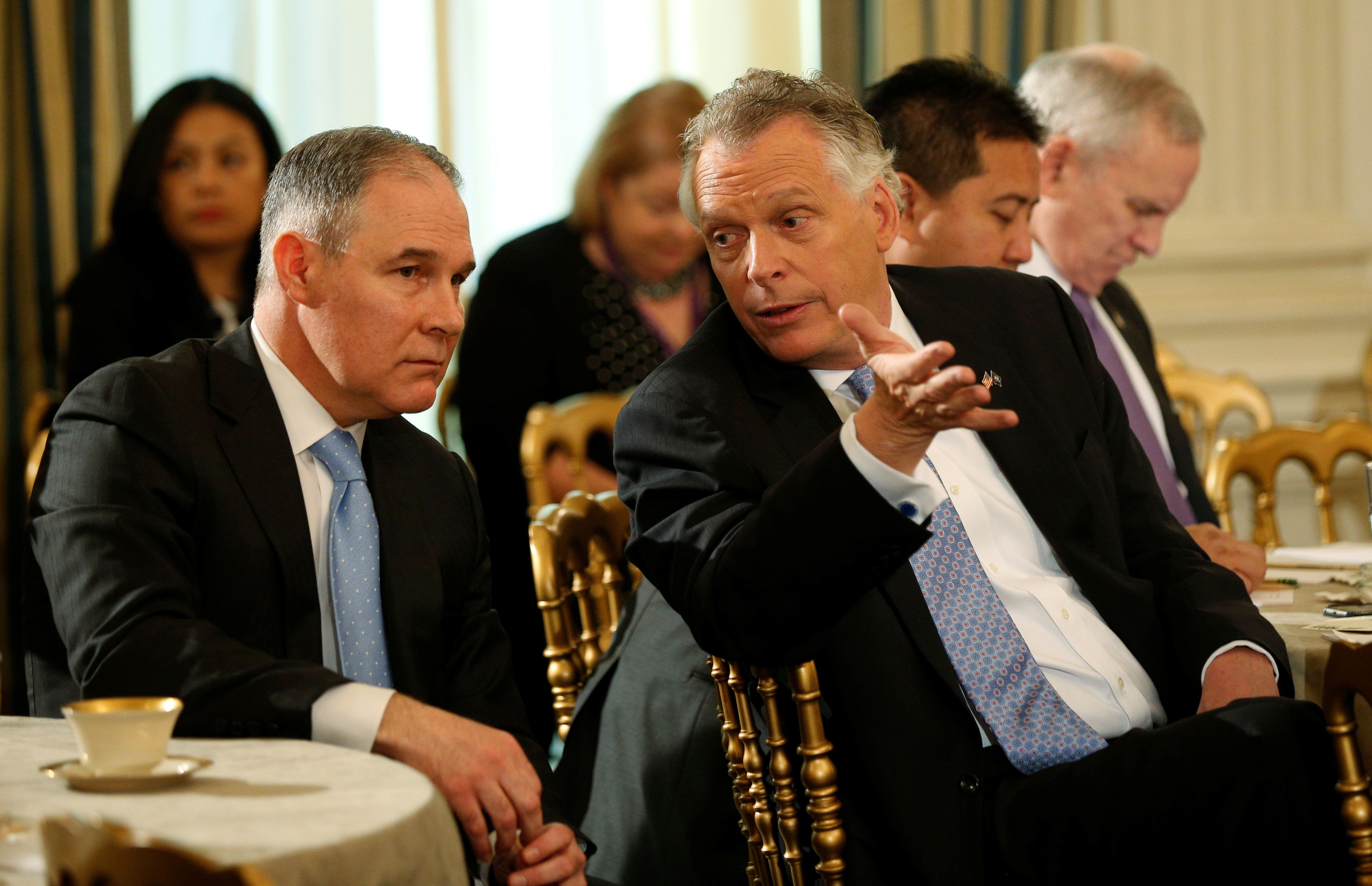 Virginia Governor Terry McAuliffe (R) talks with EPA Administrator Scott Pruitt (L) during the National Governors Association meeting hosted by U.S. President Donald Trump at the White House in Washington, U.S. February 27, 2017.  REUTERS/Kevin Lamarque