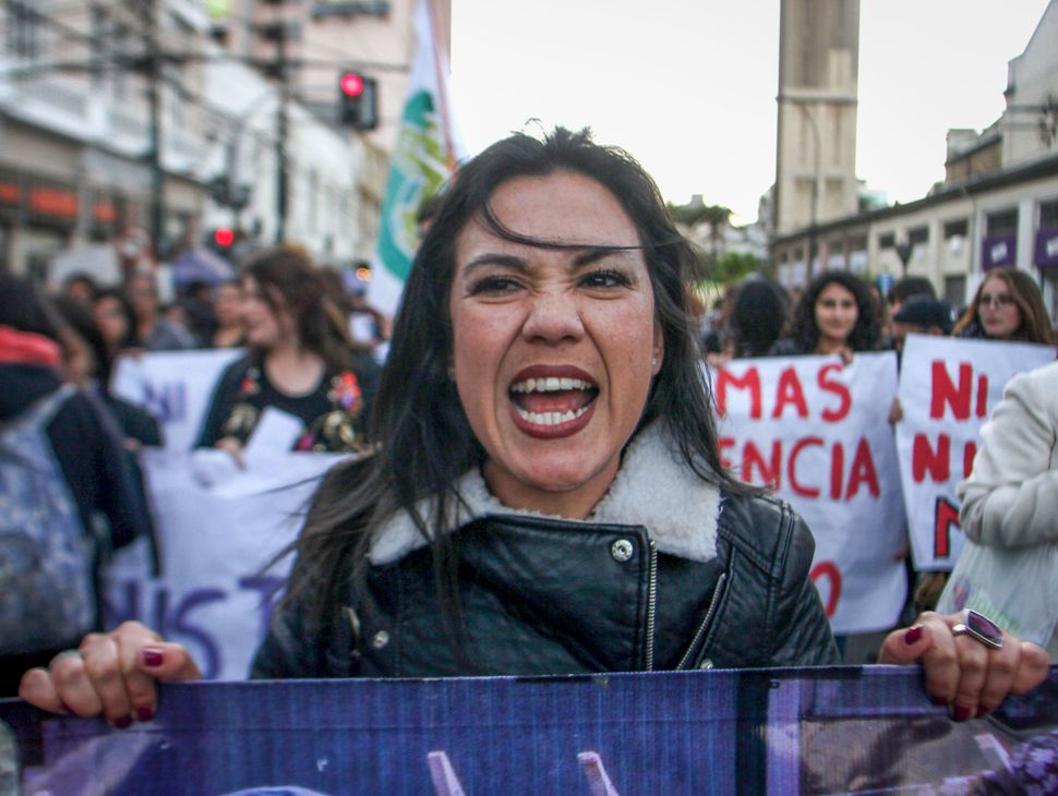 "Feminist activists protest on the streets during a national demonstration called Ni Una Menos (not one woman less)"" to demand"