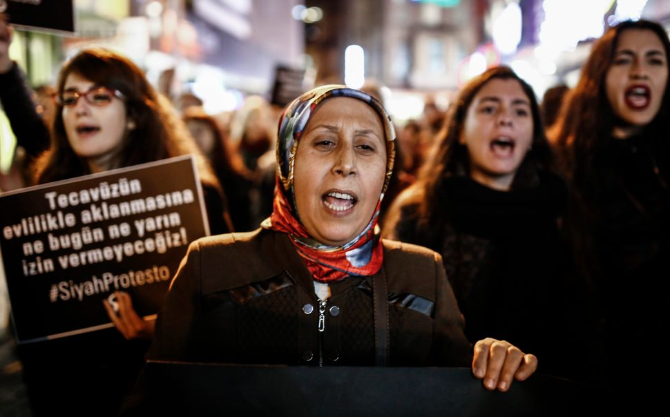 Women shout slogans and hold signs during a demonstration against a proposed bill in Istanbul on Nov. 22, 2016.