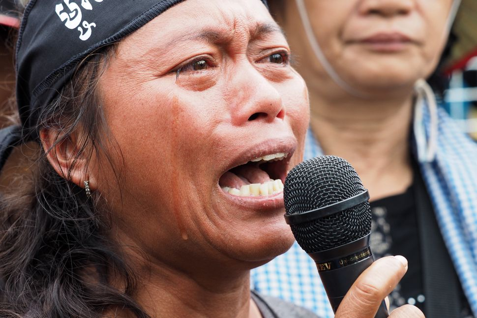 Oum Sophy, a victim of land grabs, shouts during a protest on World Habitat Day in Phnom Penh on Oct. 10, 2016.