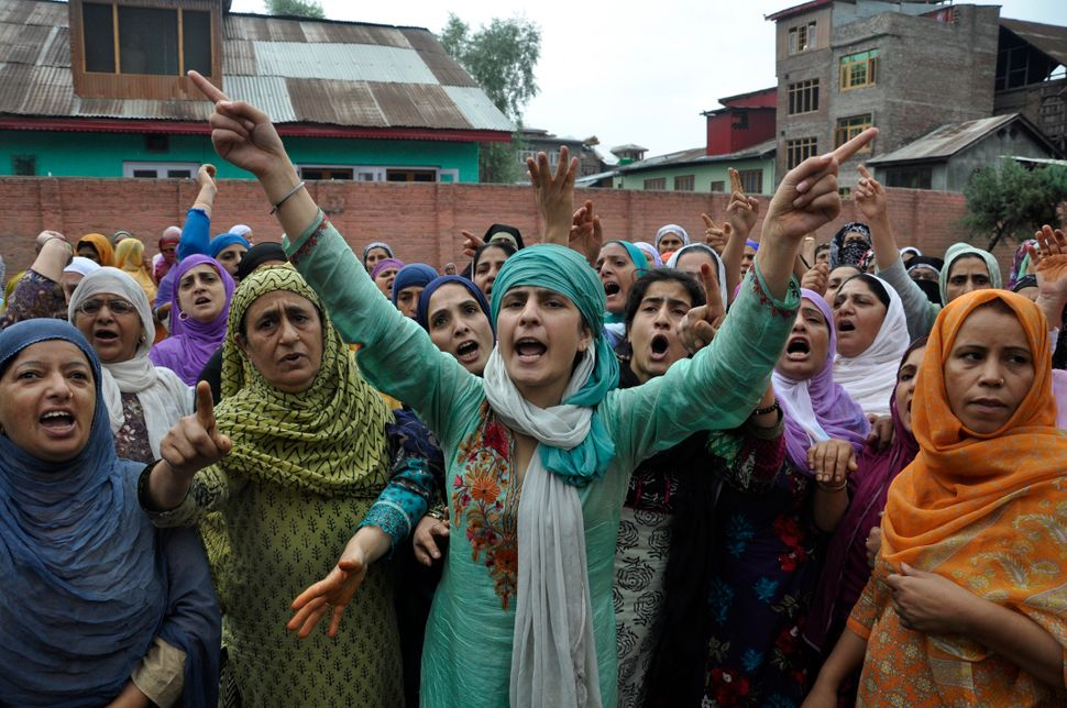 Kashmiri women chant slogans during the funeral procession of Riyaz Ahmad Shah, a civilian killed by government forces, in Sr