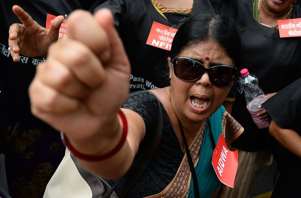 Indian women activists participate in a protest demanding the passing of the Women's Reservation Bill during the Monsoon Sess
