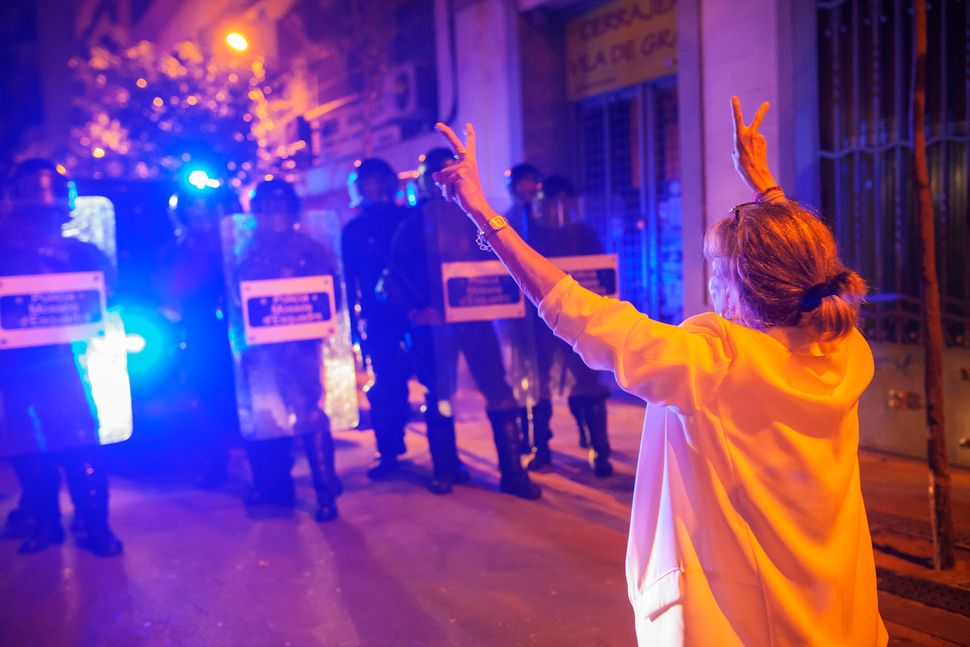 Riot police officers clash with protestors in Barcelona's Gracia neighborhood two days after the eviction of an occupied bank