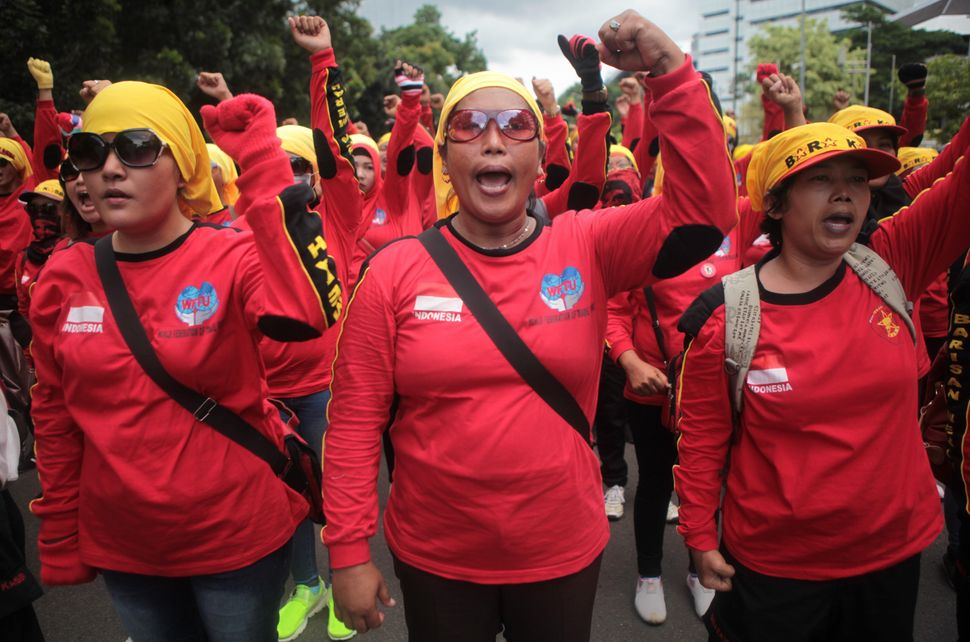 Indonesian women workers chant slogans as they hold a rally to mark the International Women's day in Jakarta, Indonesia on Ma