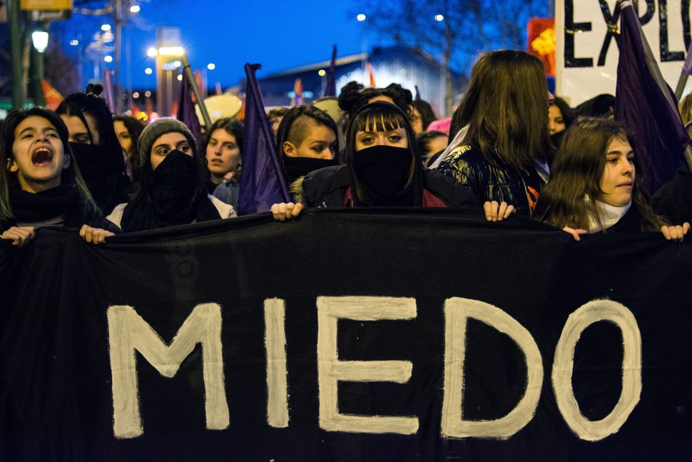 Women demonstrating on International Women's Day. On the banner the word 'fear' is written. They are demanding equality betwe