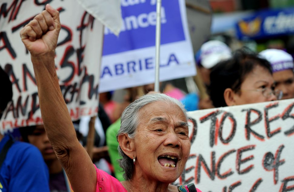 A Filipina 'comfort woman', a sex slave for the Japanese Imperial army during World War II, joins in a protest near the Malac