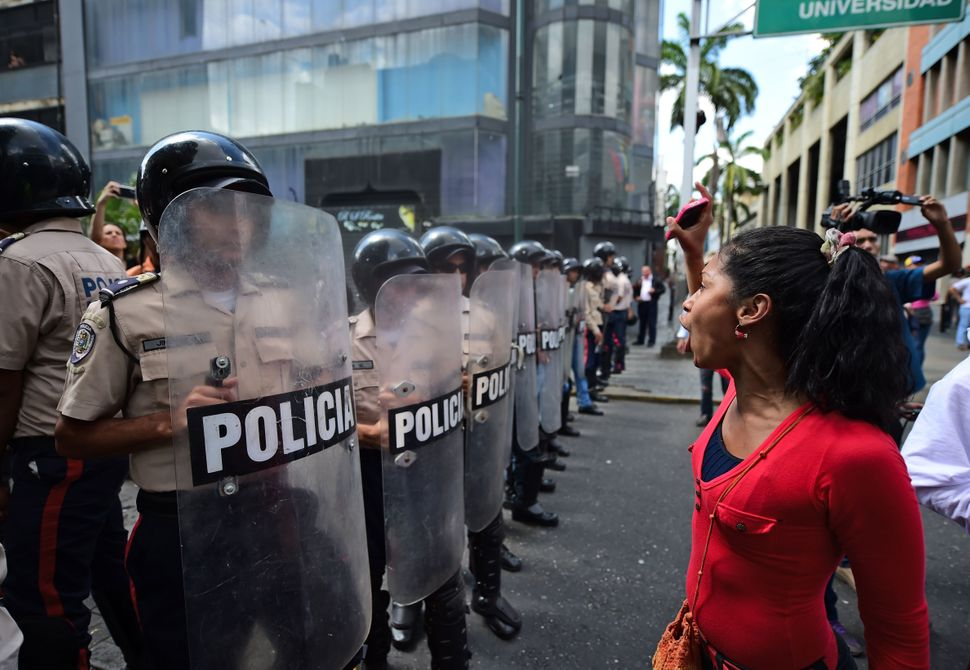 Opposition supporters rally in support of their newly elected deputies in front of the the National Assembly in Caracas, on J
