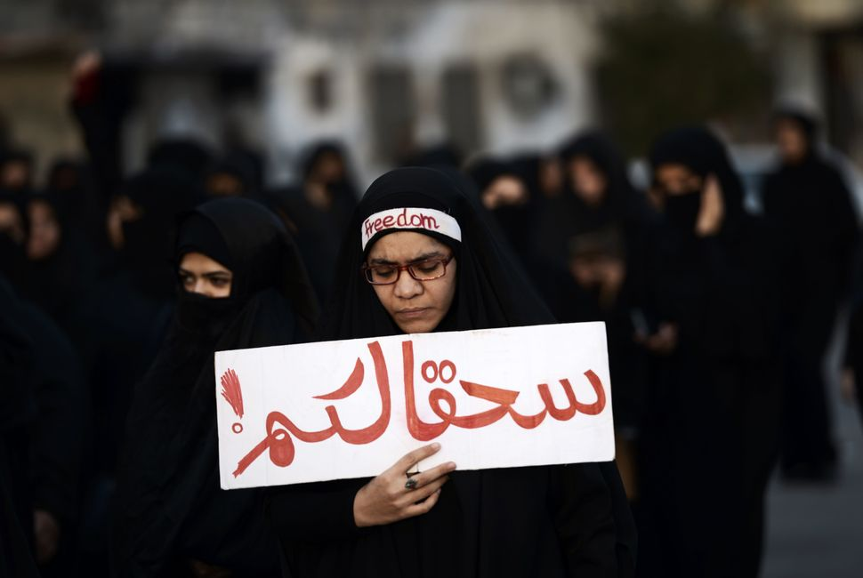 A Bahraini woman takes part in a protest in the village of Jidhafs, west of Manama, against the execution of prominent Shiite