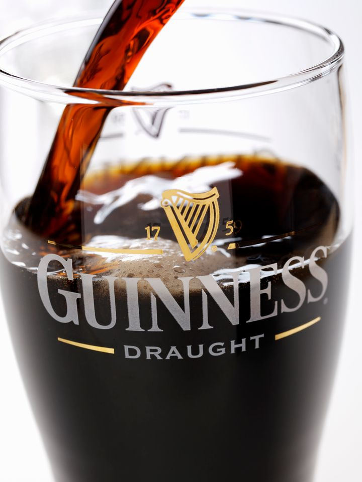 A slow pour of Guinness in front of a light shows that this beer is in fact red.