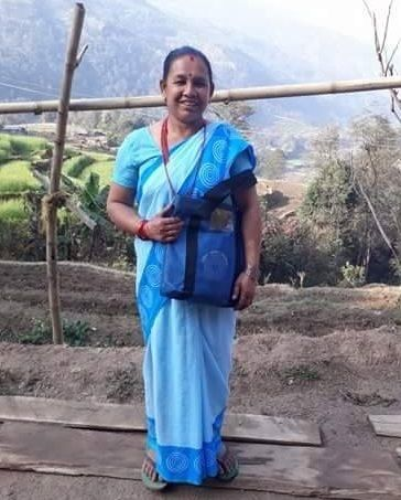 Ganga Acharya, wearing the blue sari worn by FCHVs so they are known to the community.