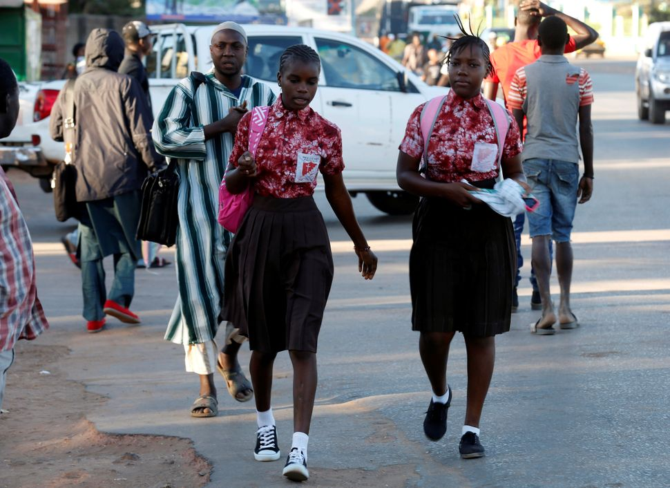 Two school girls walk at Kairaba avenue in Banjul, Gambia January 24, 2017.