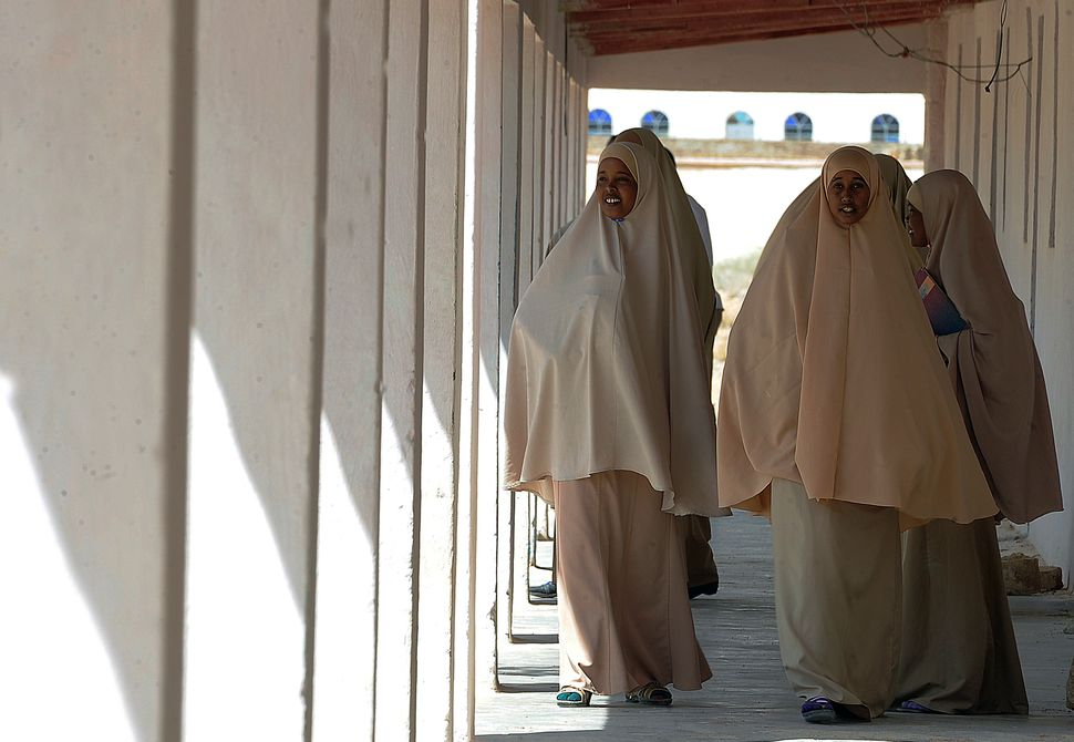 Pupils walk on September 10, 2013 inside the Gambool high school in the Garowe region, Somaliland. The school is a project fu