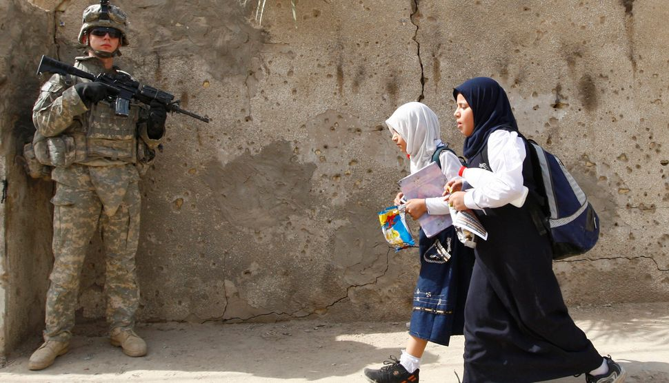 Students Walk Past A U S Soldier In Baghdads Ameen District On October