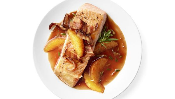 Pair juicy oranges with a salmon filet for a sweet and savory dish. Topped with crispy bacon and a red wine sauce, it's the p