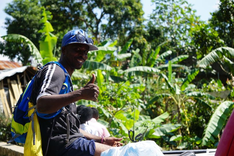 <em>Puerrot Giordani, one of three Team Tassy family members hired to join the Run Across Haiti crew this year, gives his tea