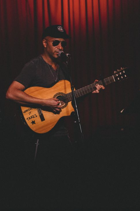 Tom Morello sings folk songs on an acoustic guitar at Hotel Cafe on February 23, 2017. His label, Firebrand Records, promotes