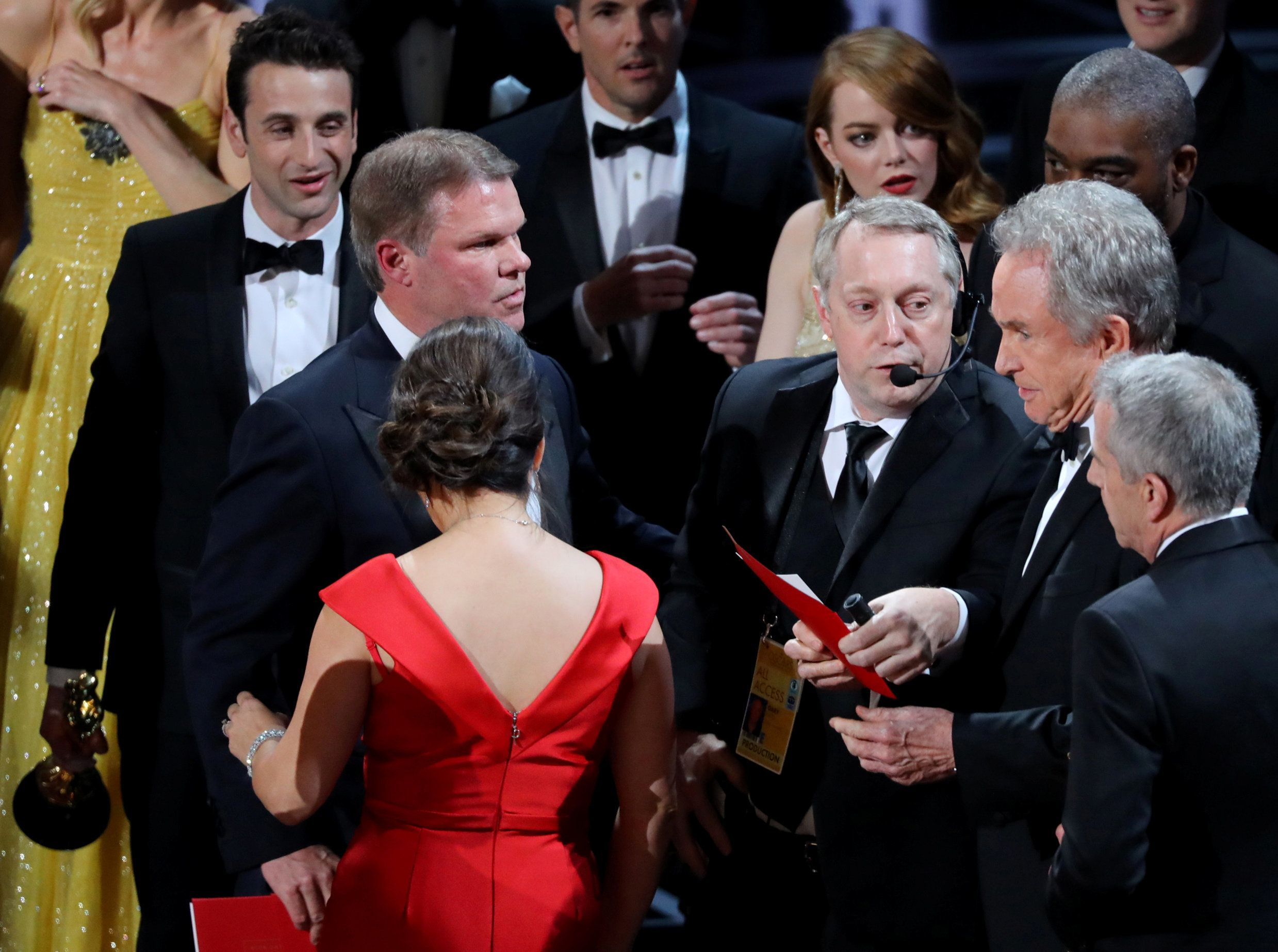 "File Photo: 89th Academy Awards - Oscars Awards Show - Hollywood, California, U.S. - 26/02/17 - Brian Cullinan (L) and Martha Ruiz of PricewaterhouseCoopers look on as presenter Warren Beatty holds the card for the Best Picture Oscar awarded to ""Moonlight,"" after announcing by mistake that ""La La Land"" was the winner. REUTERS/Lucy Nicholson/File Photo"