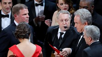 """File Photo: 89th Academy Awards - Oscars Awards Show - Hollywood, California, U.S. - 26/02/17 - Brian Cullinan (L) and Martha Ruiz of PricewaterhouseCoopers look on as presenter Warren Beatty holds the card for the Best Picture Oscar awarded to """"Moonlight,"""" after announcing by mistake that """"La La Land"""" was the winner. REUTERS/Lucy Nicholson/File Photo"""