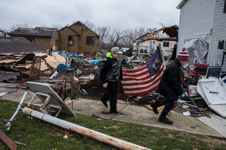 Ryan Chamberlain, 11, right, and Jacob Vogel, 12, on Wednesday, March 1, 2017 pass by the house of Jerry Nanouski, which was
