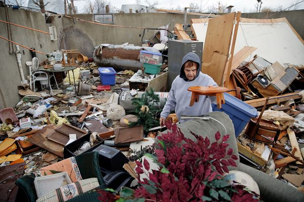 Pat Harber of Perryville, Missouri, looks through the wreckage of her home after it was destroyed by last night's tornado, on