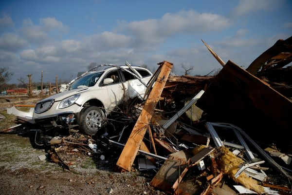 An SUV sits on a pile of wreckage off of route 51 after last night's tornado, on March 1, 2017 in Perryville, Missouri.