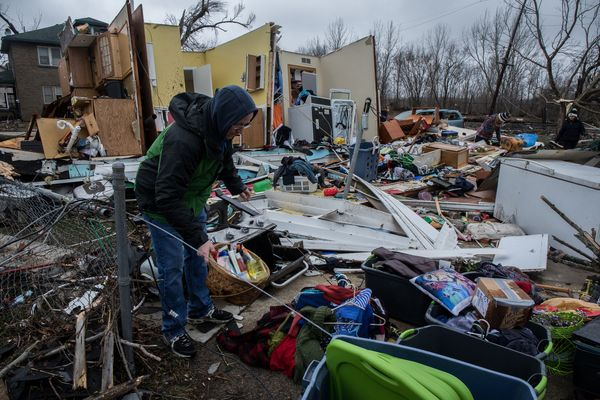 Jason and Rachel Dutton sort through their belongings on Wednesday, March 1, 2017 in a house destroyed by a tornado in Naplat