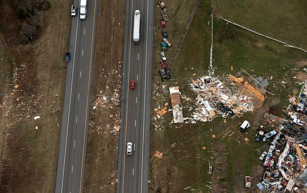 Cars are scattered near a junkyard off Interstate 55 in Perryville, Missouri.