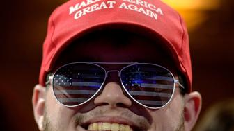 "Joe Enders of Chicago, Illinois, wears a ""Make America Great Again"" cap as he listens to remarks during the opening day of the Conservative Political Action Conference (CPAC), an annual gathering of conservative politicians, journalists and celebrities, at National Harbor, Maryland, U.S., February 22, 2017. REUTERS/Mike Theiler"