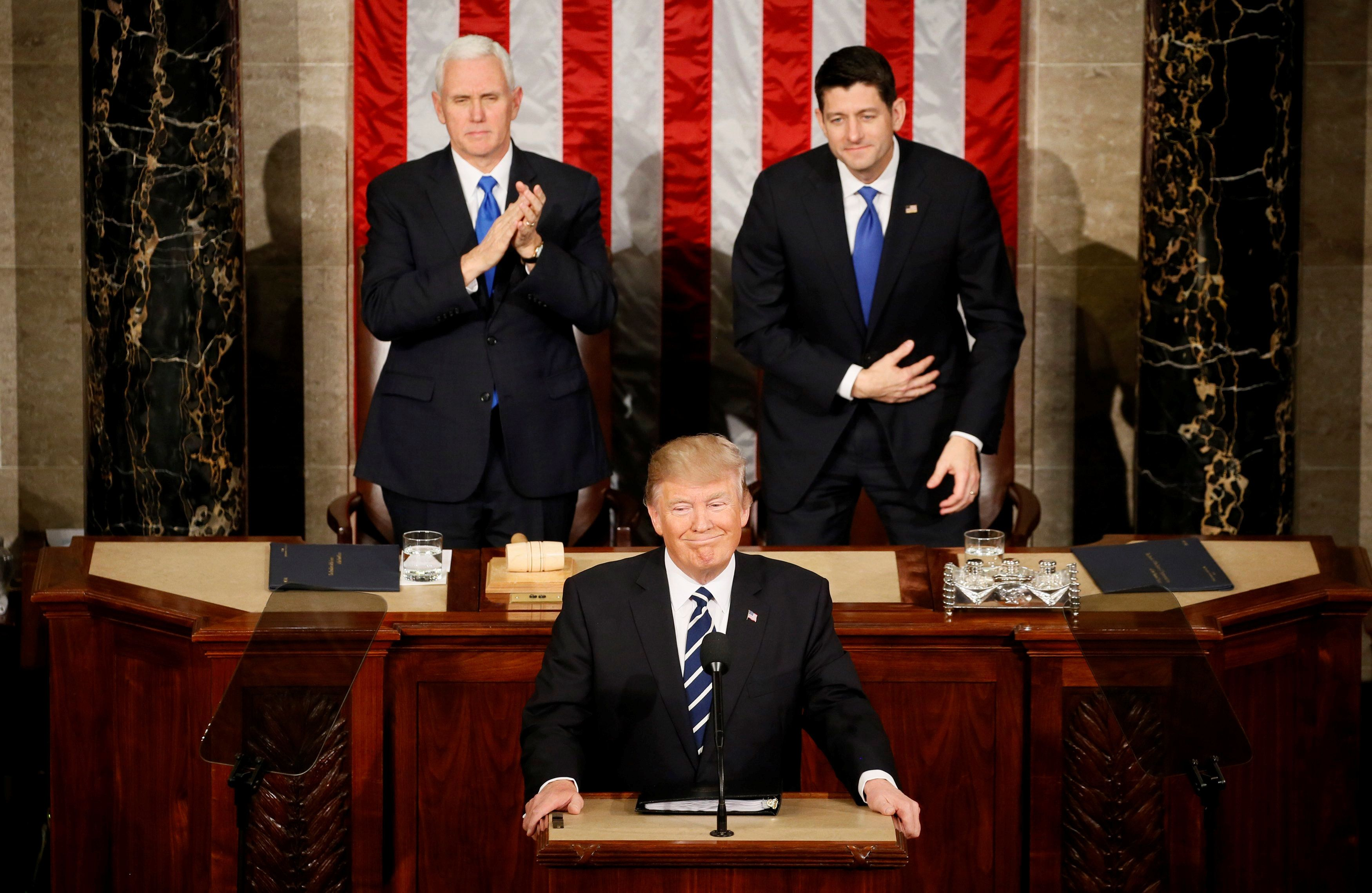 U.S. President Trump addresses Joint Session of Congress - Washington, U.S. - 28/02/17 - U.S. President Donald Trump pauses as he speaks in front of Vice President Mike Pence (L) and Speaker of the House Paul Ryan. REUTERS/Jim Bourg     TPX IMAGES OF THE DAY