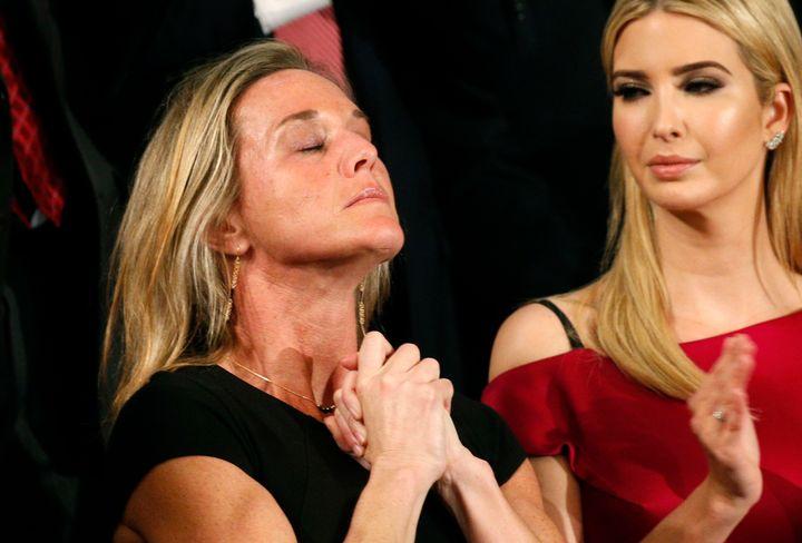 "Carryn Owens, widow of Senior Chief Petty Officer William ""Ryan"" Owens, applauds with Ivanka Trump (R), daughter of U.S. Pres"