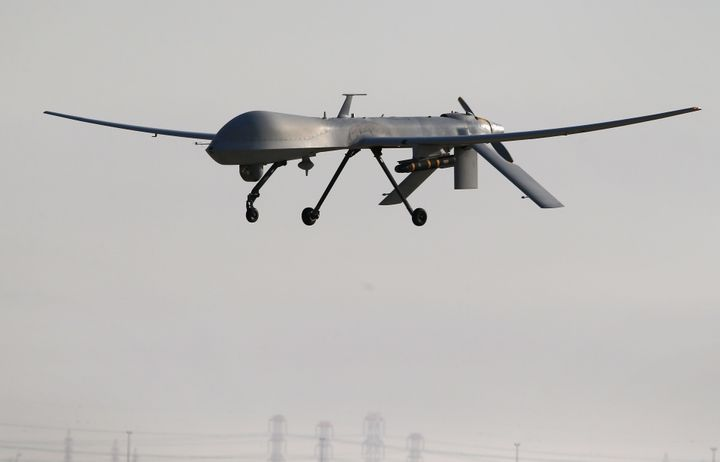 A U.S. Air Force MQ-1B Predator unmanned aerial vehicle (UAV), carrying a Hellfire missile lands at a secret air base after f