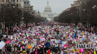 WASHINGTON, DC - JANUARY 21: With Capitol Hill in the background a crowd fills the streets on Washington, during the Women's March on January 21, 2017.  (Photo by Oliver Contreras/For The Washington Post via Getty Images)