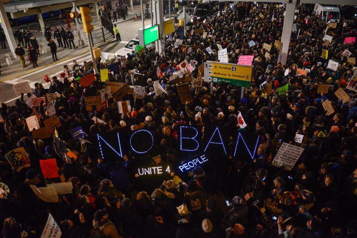 Protesters rally against President Donald Trump's travel ban at John F. Kennedy International Airport on Jan. 28, 2