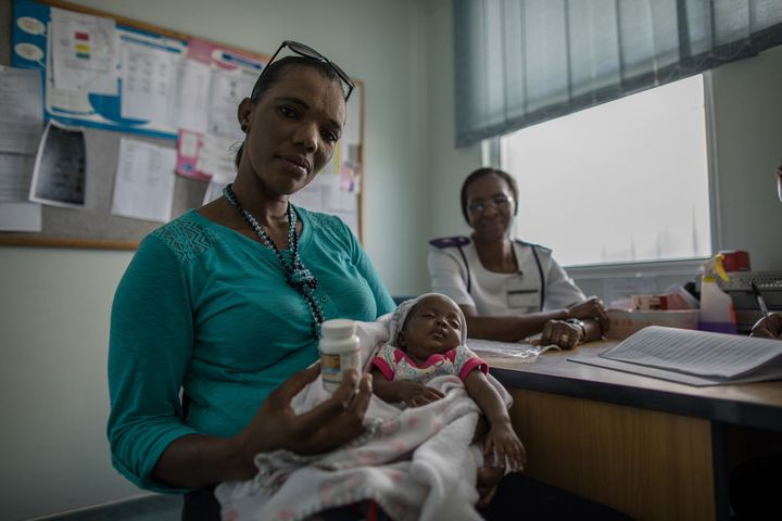 """<p>Nurse Ruusa Shipena has more time to spend with her clients, including Katrina Kambunde, 42. Katrina is HIV-positive, but thanks to the services at Shanamutango HIV clinic, her baby was born HIV-negative. """"We were short on the ground, especially when it came to nurses and admin staff,"""" Shipena says. """"Then IntraHealth came in and gave us more staff. Now some can draw blood, while some can do counseling, while some do pediatrics. To us, it's our rescue."""" </p>"""