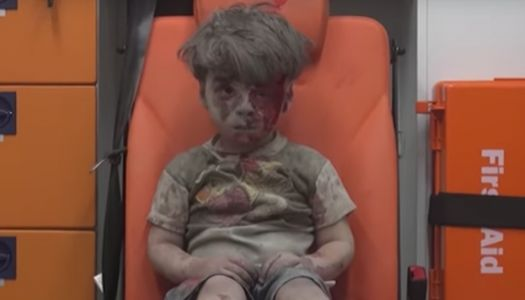 <em>Syrian child pulled from rubble</em>