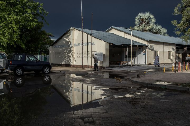 <p>Onandjokwe Hospital serves as the primary health care center for the Onandjokwe District of the Oshikoto Region, which spans about 25,000 kilometers. Before decentralization, it was the only place where over 81,000 people could get HIV-related services. This photo was taken after one of the few rains during what should have been the region's rainy season. By the next morning, the ground was bone dry once more.</p>