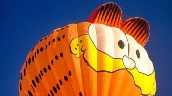 Garfield cartoon character shaped hot air balloon at the Albuquerque International Balloon Fiesta, New Mexico, USA. (Photo by: MyLoupe/UIG via Getty Images)
