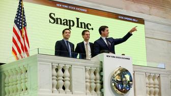Snap cofounders Evan Spiegel (C) and Bobby Murphy ring the opening bell of the New York Stock Exchange (NYSE) with NYSE Group President Thomas Farley shortly before the company's IPO in New York, U.S., March 2, 2017.  REUTERS/Lucas Jackson