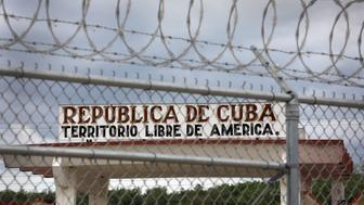 GUANTANAMO BAY, CUBA - OCTOBER 23:  (EDITORS NOTE: Image has been reviewed by the U.S. military prior to transmission) The Northeast Gate of the U.S. Naval Station at Guantanamo stands as the only entrance into the rest of Cuba on October 23, 2016 in Guantanamo Bay, Cuba. U.S. Marines guard the perimeter of the base, which in the 1960's was a flashpoint between the United States and Cuba. The base holds the U.S. prison known as 'Gitmo,' which is run by the military's Joint Task Force Guantanamo. President Obama issued an executive order in 2008 to close the prison, which has failed because of political opposition in the U.S.  (Photo by John Moore/Getty Images)