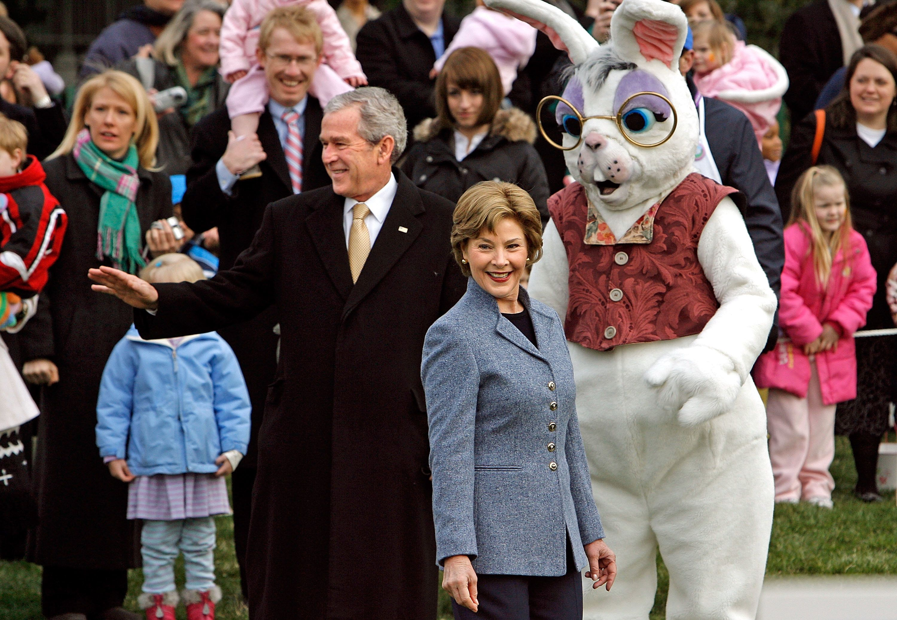 President George W. Bush, first lady Laura Bush and the Easter Bunnywelcome guests to the annual Easter Egg Roll on Mar