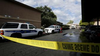 Crime scene tape surrounds buildings at the Autumn Ridge apartment complex which had been searched by investigators in Phoenix, Arizona May 4, 2015. Texas police shot dead two gunmen who opened fire on Sunday outside an exhibit of caricatures of the Prophet Mohammad that was organized by a group described as anti-Islamic and billed as a free-speech event. Citing a senior FBI official, ABC News identified one of the gunmen as Elton Simpson, an Arizona man who was the target of a terror investigation.  REUTERS/Nancy Wiechec